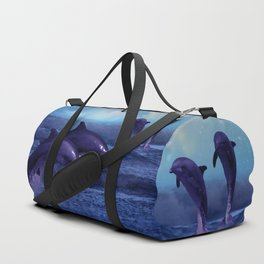 Dolphins play Duffle Bag