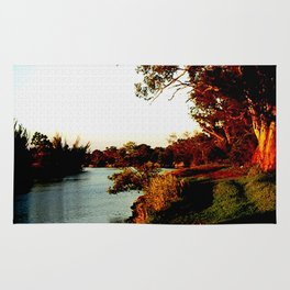 Sunsets on the river bank gum Trees Rug