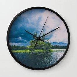 tree island on a stormy lake Wall Clock