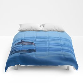 Spotted dolphin jumping in the Atlantic ocean Comforters