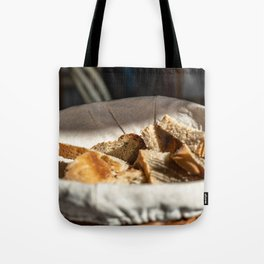 A bread basket on an italian table Tote Bag