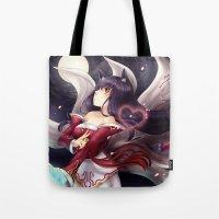 league Tote Bags featuring League of legends Ahri by Rikku Hanari