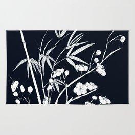 bamboo and plum flower white on black Rug
