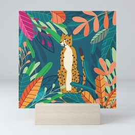 Cheetah chilling in the wild Mini Art Print