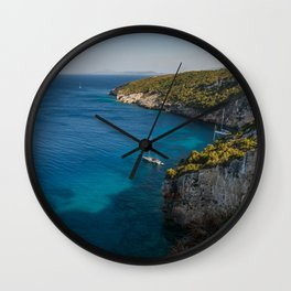 A picturesque Mediterranean view with yachts Wall Clock