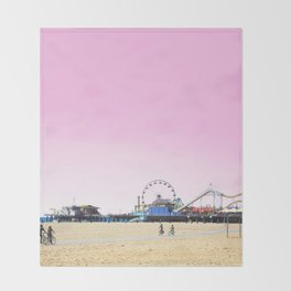 Santa Monica Pier with Ferries Wheel and Roller Coaster Against a Pink Sky Throw Blanket
