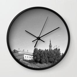 Monastery on the river bank Wall Clock