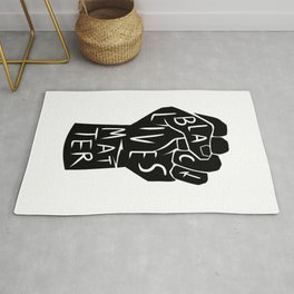black lives matter | black power fist (in black) Rug