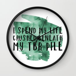 I Spend My Life Crushed Beneath My TBR! (Green) Wall Clock