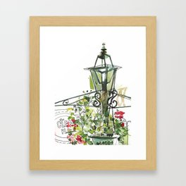 Lamp post with hanging flowers Framed Art Print