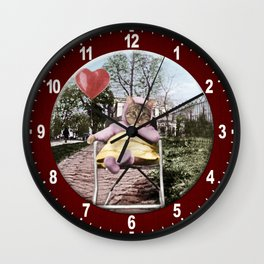 A pretty, little kitty with a heart-shaped balloon Wall Clock