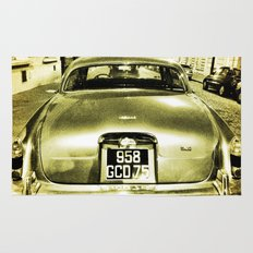 Old Jaguar on the streets of Paris Rug