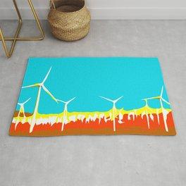 wind turbine in the desert with blue sky Rug