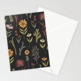 flat lay floral pattern on a dark background Stationery Cards