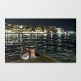 Pondering life at the harbour in Chania Canvas Print