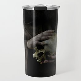 Holding a male skull Travel Mug