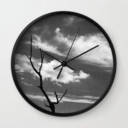 Black and white dead tree and sky with wispy clouds Wall Clock