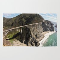 big sur Area & Throw Rugs featuring Big Sur Bridge by The Aerial Photography Shop