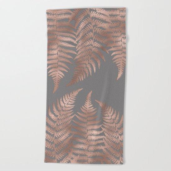Rosegold fern leaves on grey Beach Towel