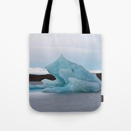 Big blue iceberg in front of a glacier Tote Bag