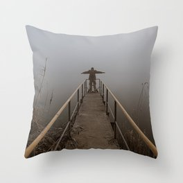 Man with open arms on a frozen pier shrouded in mist Throw Pillow