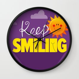 Keep smiling quote Wall Clock
