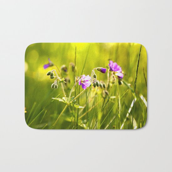 Beautiful meadow flowers - geranium on a sunny day - brilliant bright colors Bath Mat