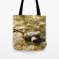vintage camera Tote Bags featuring camera by inesmarinho