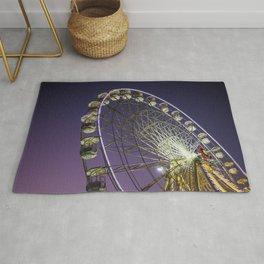 Ferris wheel in a purple sky Rug