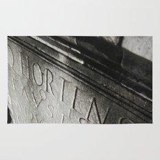 wisdom in stone. Rug