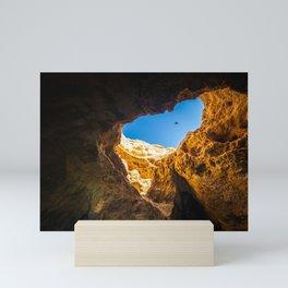 Dramatic sea cave along Algarve coast in Portugal Mini Art Print