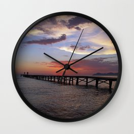 Anglers in the sunrise at the sea Wall Clock