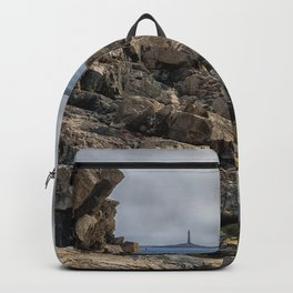 Twin lights cloudy day Backpack