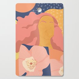 Women with eyebrow in the desert with flowery coat Cutting Board