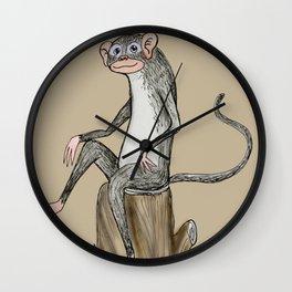 Monkey sitting on a log Wall Clock