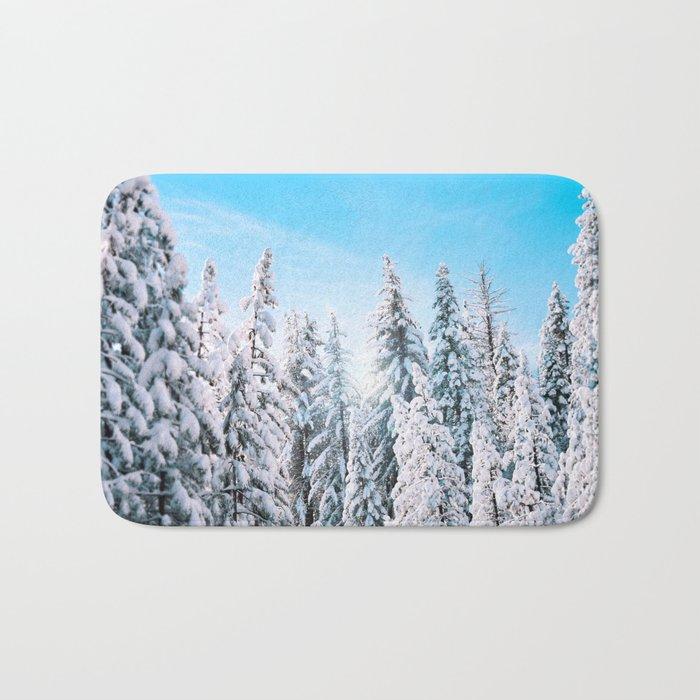 Snow covered evergreens Bath Mat