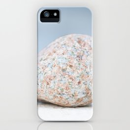 Granite pebble with blue water background iPhone Case