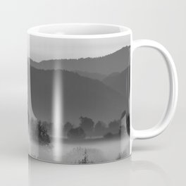 Fog rolling through valley in black and white Coffee Mug