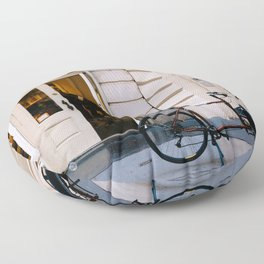Old bicycle parked at luxury fashion store in New York Floor Pillow