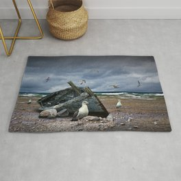 Shipwrecked Wooden Boat on a Rocky Beach with Gulls Rug