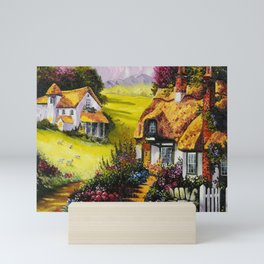 Rustic landscape with houses and sheep in the meadow Mini Art Print