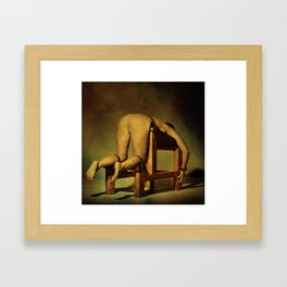 Tied on the whipping bench - Nude woman in bondage Framed Art Print