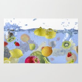 Fresh Fruits shot as they submerged under water background food delicious splash in aquarium Rug