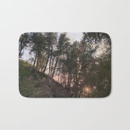 sunset in the forest Bath Mat