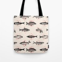 red Tote Bags featuring Fishes In Geometrics (Red) by Florent Bodart / Speakerine