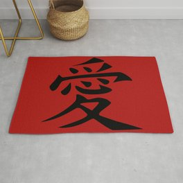 The word LOVE in Japanese Kanji Script - LOVE in an Asian / Oriental style writing. - Black on Red Rug
