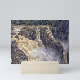 Powerful water going over the falls Mini Art Print