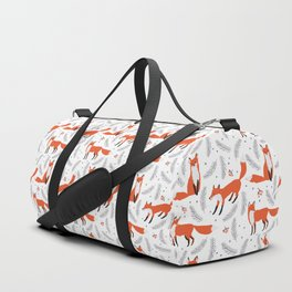 Red foxes and berries in the winter forest Duffle Bag