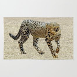 Baby cheetah learning to stalk Rug