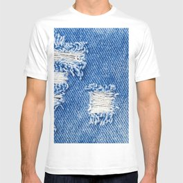Hole on Denim Jeans. Ripped Destroyed Torn Blue jeans background. Close up blue denim  jean texture  T-shirt